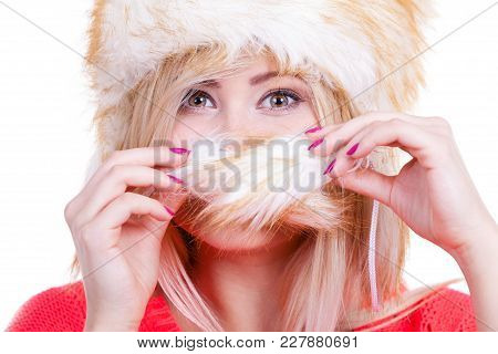 Clothing Accessories, Seasonal Clothes Concept. Woman Wearing Winter Furry Warm Hat Hiding Behing Fu
