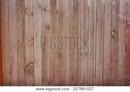 Vintage Wooden Fence With Traces Of Old Paint, Scuffs And Scratches. Photo Close-up