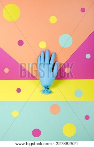 Abstract Composition With A Rubber Glove On A Colored Background
