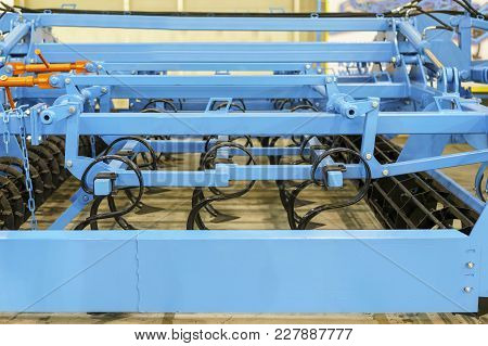 Details And Components Of Agricultural Machinery. Cultivator For Tillage And Fertilizer Application.