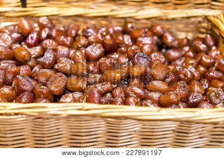 Dates Fruit. Pile Of Fresh Dried Date Fruits In A Basket. Fresh Healthy Food.