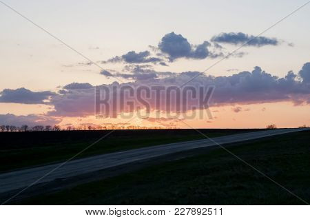 Road To A Sunset. Endless Steppe Landscape On A Clear Spring Evening.