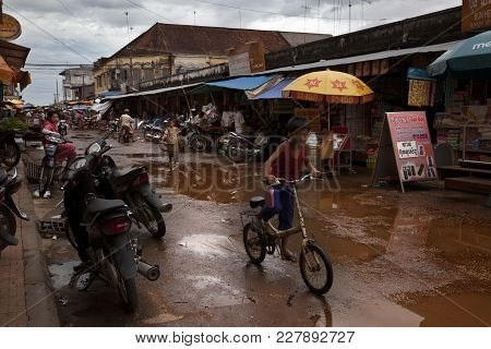 Kampong Chhnang, Cambodia-august 2, 2009. On The Streets Of Any City In Cambodia, After The Monsoon