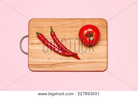 Healthy Eating. Two Red Chili Pepper Near Fresh Tomato On A Wooden Chopping Board