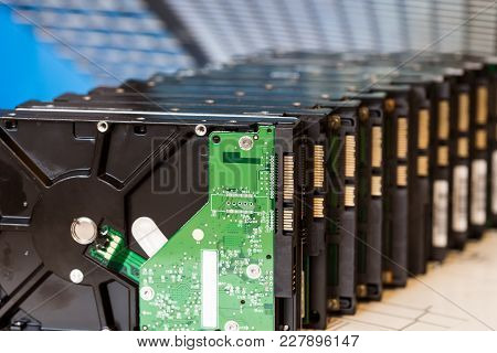 Pile Of Old Hard Drives At White Background Selective Focus