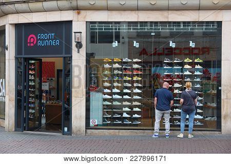 Amsterdam, Netherlands - July 8, 2017: People Shop At Front Runner Footwear Store In Amsterdam. Amst