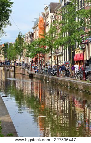 Amsterdam, Netherlands - July 8, 2017: People Visit Red Light District In Amsterdam, Netherlands. Am