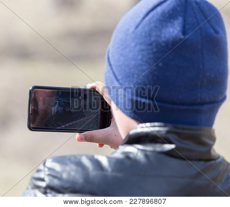 The Hand With The Phone Shoots Video .