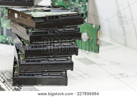 Pile Of Old Hard Drives At White Background