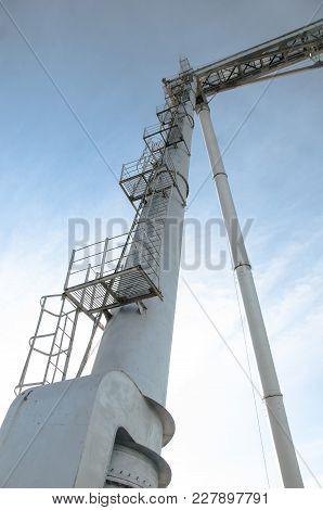 Gantry Crane In Winter Day. High Ladder To Climb On The Crane.