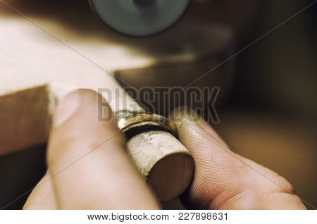 Craft Jewelery Making. Ring Polishing. Macro Shot.