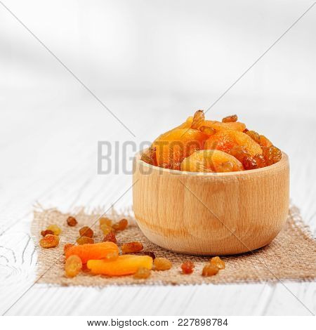 Delicious Dried Apricots And Raisins In The Bowl. Square. The Concept Is Healthy Food, Vegetarianism