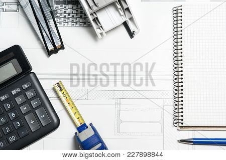 Work Space Table With Notepad, Tape Measure, Calculator On Grey Background. Top View, Flat Lay