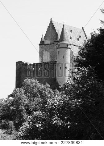 The Magnificent Chateau Dé Vianden In Luxembourg Towers Above Forest Trees On A Hill On A Sunny Summ