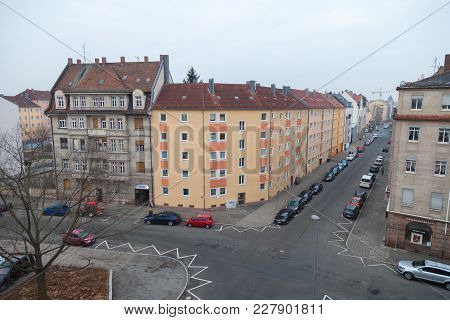 Fuerth / Germany - February 21, 2018: Crossroad With Parked Cars On The Side In A Residential Distri