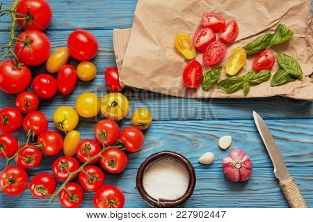 Tomatoes, Basil And Spices On A Vintage Wooden Background. Ingredients For Salad Preparation. Top Vi