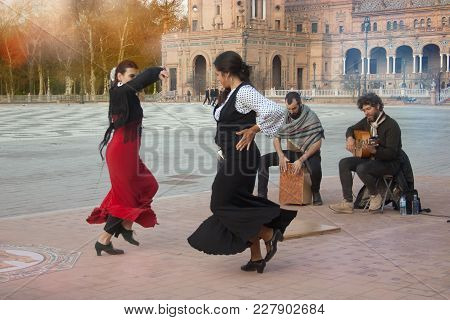 A Group Of Flamenco Performers Dance And Sing In Plaza De España.spain, Seville, February 2018.