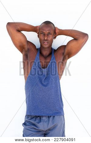 Handsome African American Exercise Man Standing Against White Wall With Hands Behind Head
