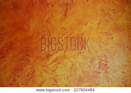 Bright Colored - Orange, Yellow, Red - Grunge Concrete Wall Texture Background.