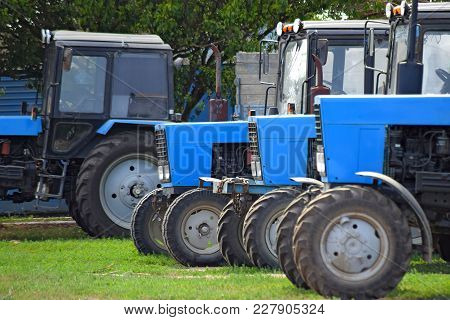 Tractor, Standing In A Row. Agricultural Machinery. Parking Of Agricultural Machinery.