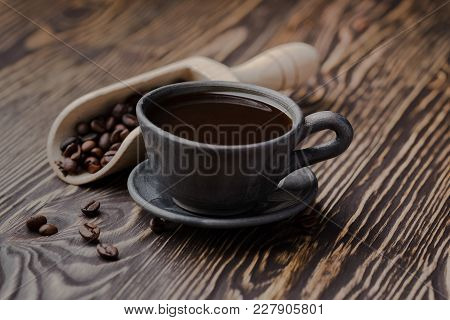 Strong Black Coffee Beans,coffee, Black Roasted Arabica Coffee Beans And Cup Full Of Coffee