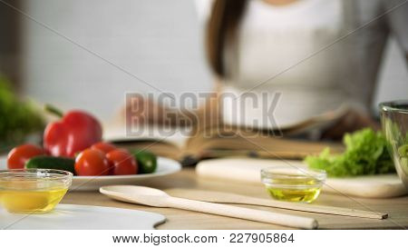 Close-up Of Girl Flipping Through Cooking Book Pages, Choosing Salad Recipe, Stock Footage