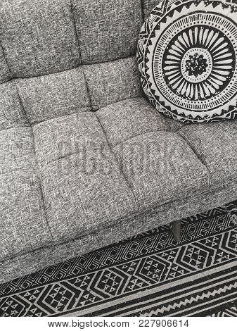 Beautiful Interior Design In Gray Tones. Sofa, Round Cushion And Decorative Rug.