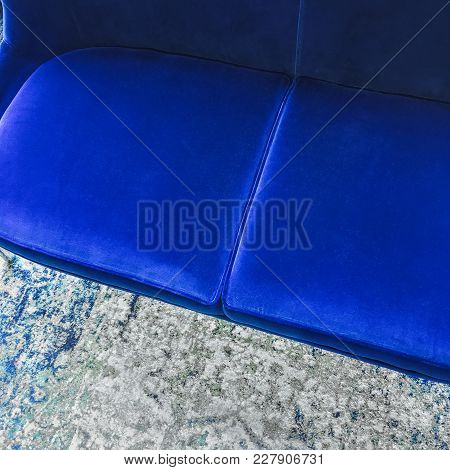 Close-up Of A Luxurious Blue Velvet Sofa On A Fashionable Rug. Classy Furniture.