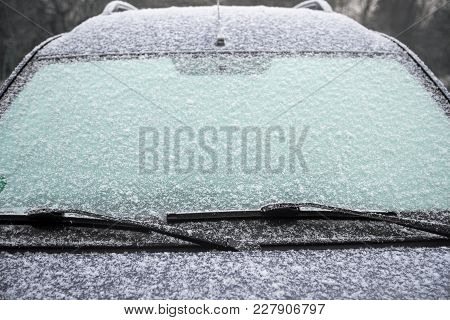 Frozen Windshield Of A Car With Ice And Snow, Concept Of Traffic Risks In Winter, Copy Space, Select