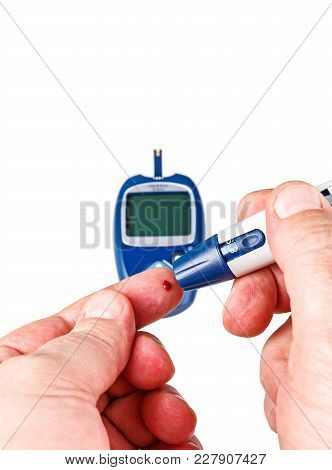Blood From The Finger, With A Glucometer On A White Background.