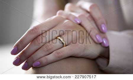 Close-up Of Female Hands Lying On Knees With Gold Engagement Ring, Jewelry, Stock Footage