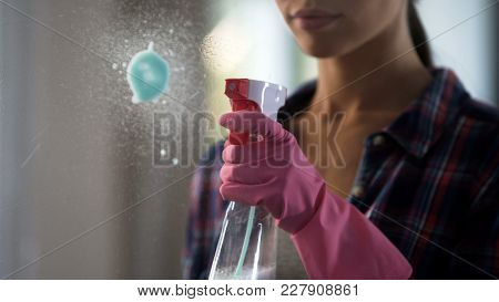 Woman Masterfully Struggling With Stains On Glass, Using New Cleaning Agent , Stock Footage