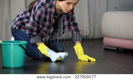 Woman Upset With Poorly Polished Floor And Stains On Wood Parquet, Cleaning, Stock Footage