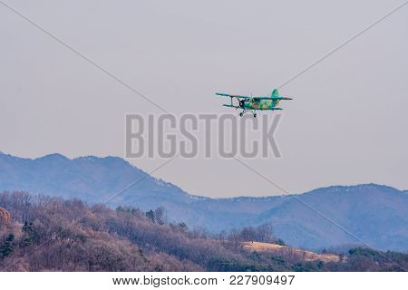 Chungju, South Korea, February 22, 2018: Rok Military Biplane Training Aircraft Flying Over Mountain