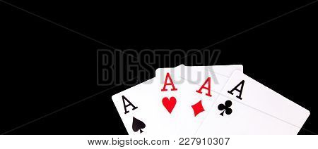 A Winning Poker Hand Of Four Aces Playing Cards Suits On Black Background