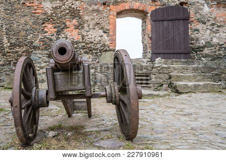 Old Brass Cannon In The Courtyard Of The Ruins Of The Medieval Bolkow Castle In Lower Silesia, Polan