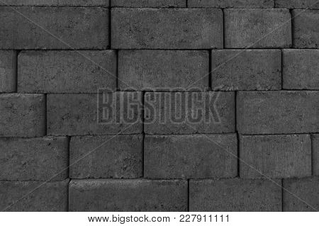 Gray paving slabs piled in the piles poster