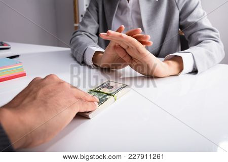 Close-up Of A Person's Hand Refusing Bribe