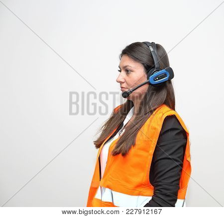 Brunette Woman With Wireless Headset Voice Picking System Control