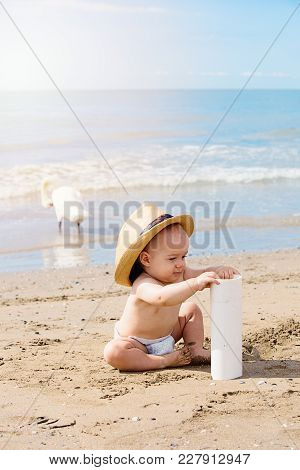 Close Up Portrait Of Smiling Little Boy Playing On The Beach  On Summer Vacation. Travel And Adventu
