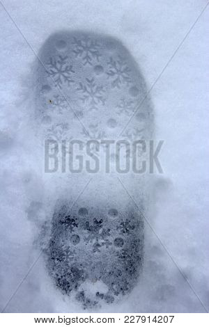 Trace On Snow. Fresh Snowy Shoeprint. Wintertime - Road Covered With Snow With Trace. Shoe Print On