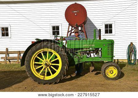 Rollag, Minnesota, Sept 2, 2017: The Unidentified Operator Of An Old John Deere B Tractor Filling Ga