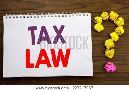 Conceptual Hand Writing Caption Inspiration Showing Tax Law. Business Concept For Taxation Taxes Rul