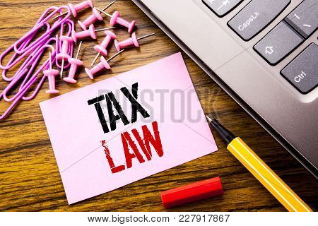 Handwritten Text Showing Tax Law. Business Concept For Taxation Taxes Rule Written On Pink Sticky No