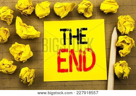 The End. Business Concept For End Finish Close Written On Sticky Note Paper On Vintage Background. F