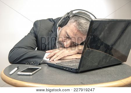 Senior Business Man Fallen Asleep With Hypnosis Self Help Audio Book, Exhausted And Tired