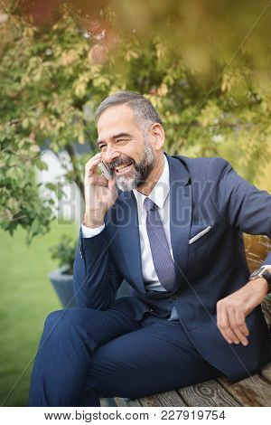 Smart Senior Business Man, An Elderly Entrepreneur And Business Owner, Talking Over His Cell Phone I