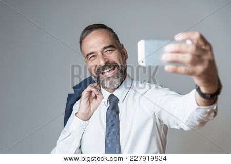 Happy And Cheerful Business Man Taking A Selfie, Posting Image On Social Media