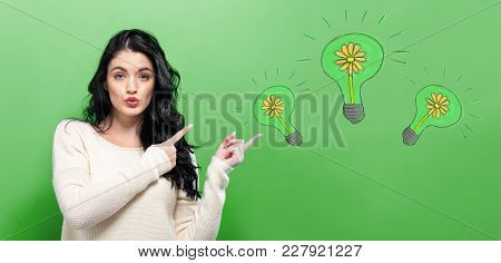 Eco Energy With Young Woman On A Green Background