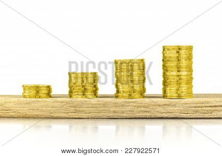 Investment, Money, Interest And Financial Concept. Gold Coin On Wood Counter Isolated On White Backg